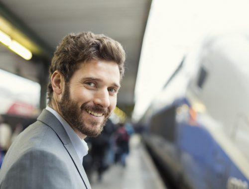 Portrait of cheerful man on platform station. looking camera